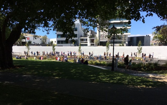 The south bank of the memorial from the shade of trees on the north bank