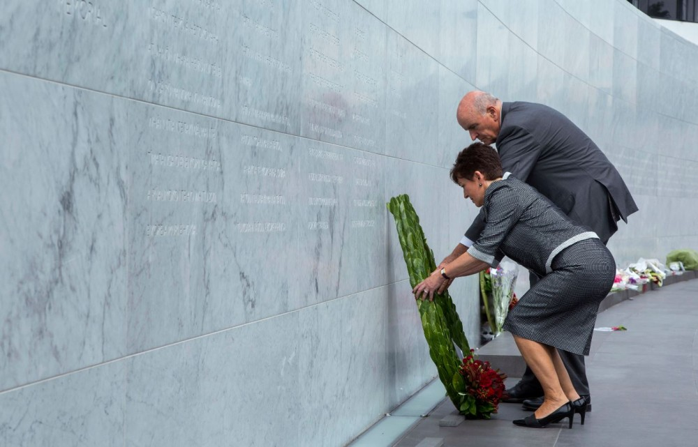 Governor General Dame Patsy Reddy laying a wreath at the sixth anniversary commemoration service