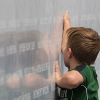 EQM Photo of memorial wall with young boy 22022017